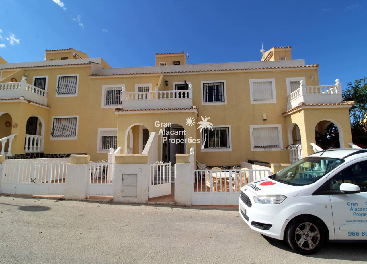 Gran Alacant Properties REF 10301 Gran Alacant townhouse overlooking pool and gardens